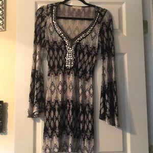 Dress, patterned with gem stones around neck line
